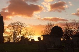 Bright evening winter sky over the churchyard